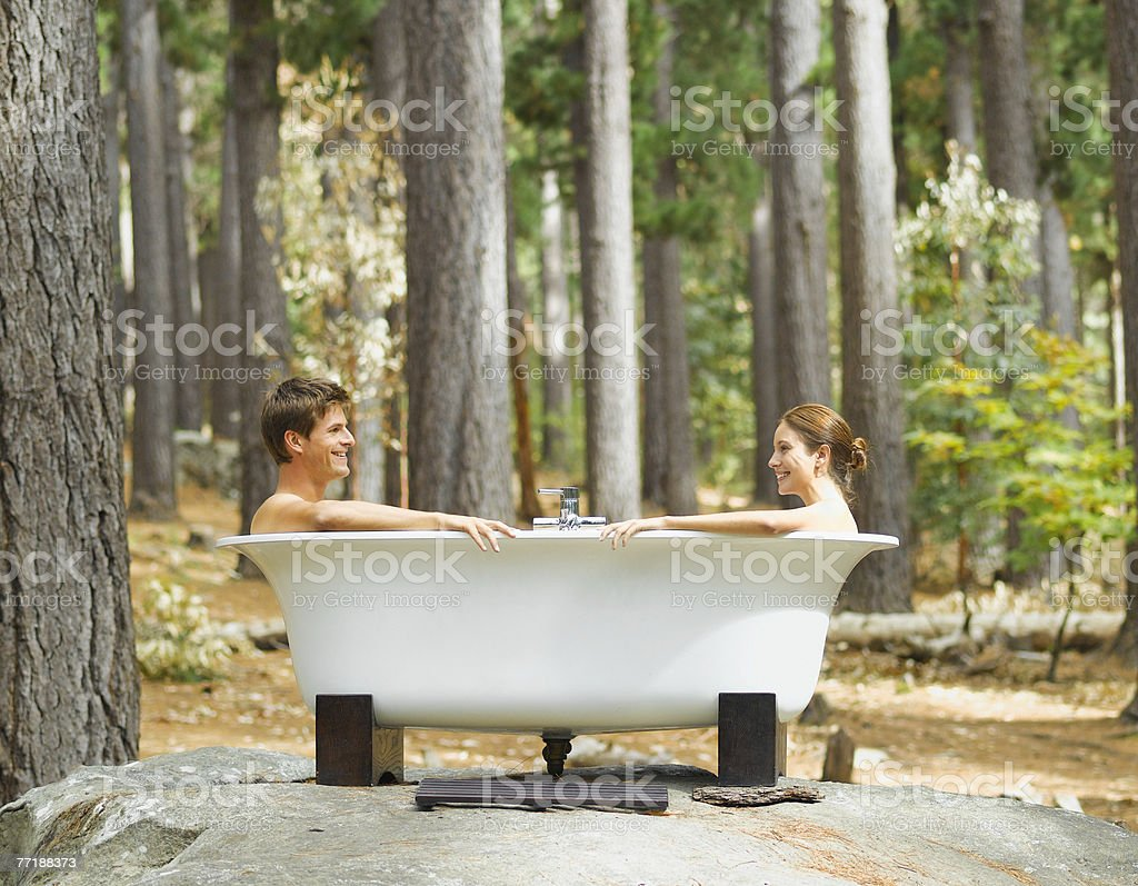 A couple bathing outdoors in the woods royalty-free stock photo