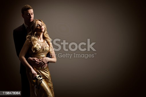 Couple Beauty Portrait, Dreaming Beautiful Woman and Man studio portrait on gray background, Love concept