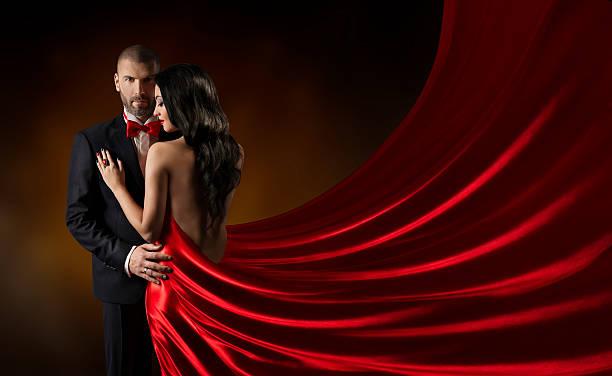 paar schönheit porträt, mann in anzug und frau roten edle kleid - festliche kleider kindermode stock-fotos und bilder