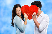 istock Couple behind the red heart 174823417