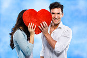 istock Couple behind the red heart 174823529