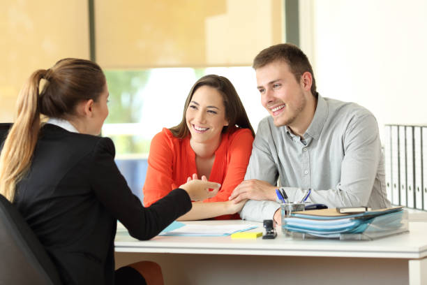 couple being attended by office worker - employee engagement stock photos and pictures
