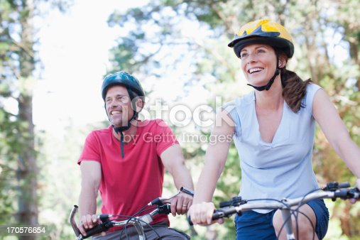 istock Couple bicycle riding in forest 170576654