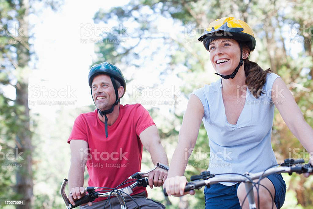 Couple bicycle riding in forest stock photo