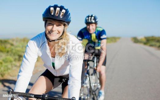 istock Couple bike riding in remote area 88688757