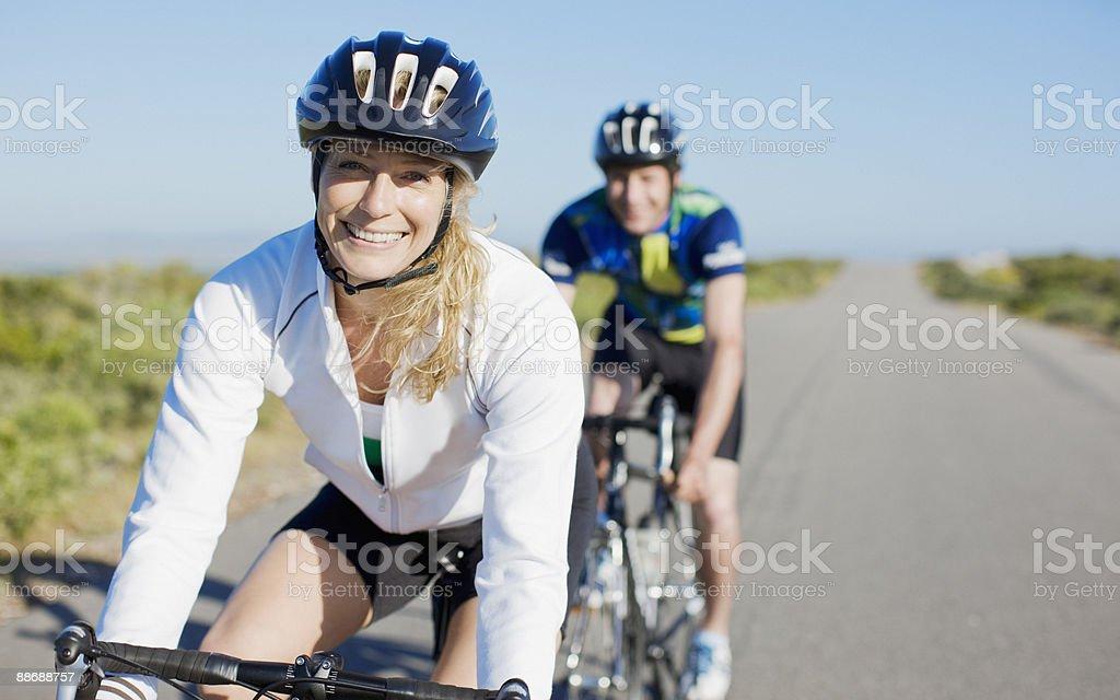 Couple bike riding in remote area stock photo