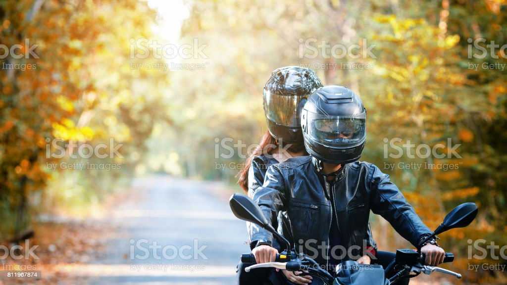 couple biker riding motorcycle stock photo
