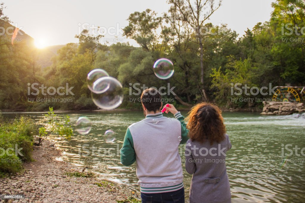 Couple blowing bubbles royalty-free stock photo