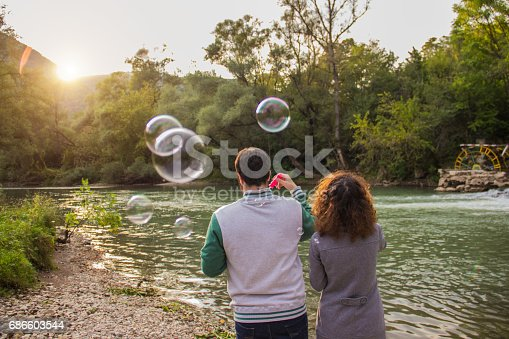 Couple Blowing Bubbles Stock Photo & More Pictures of Adult