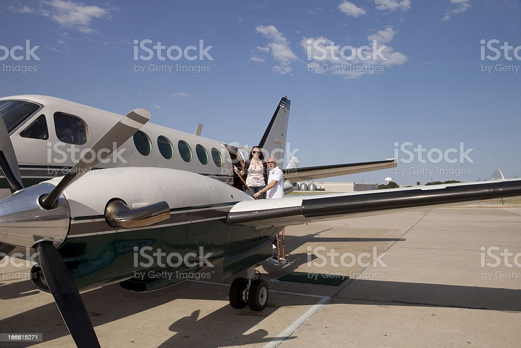 Couple Boards a Private Trobo Prop Aircraft stock photo