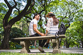 Boyfriend and girlfriend having fun on a date together in a public park