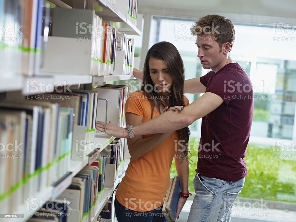 couple breaking up in library stock photo