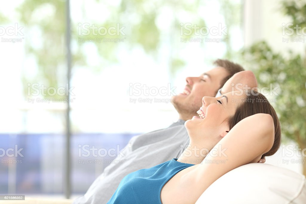 Couple breathing and resting at home - foto de stock