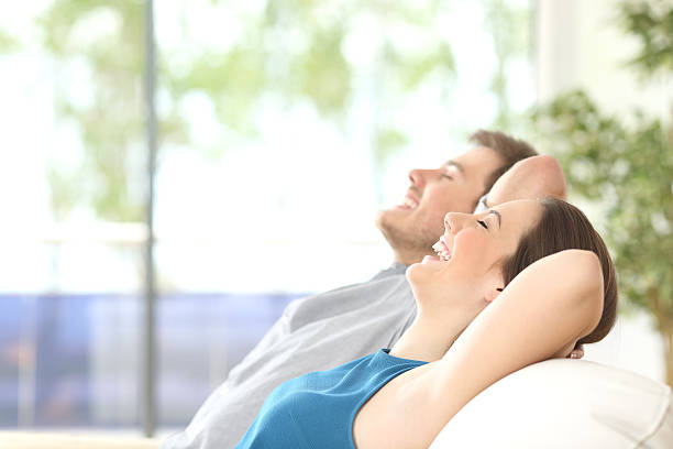 Couple breathing and resting at home stock photo