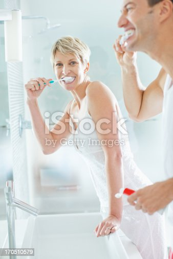 675462768istockphoto Couple brushing teeth in bathroom 170510579