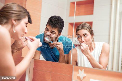 874030164 istock photo Couple brushing teeth in the bathroom together 823970106