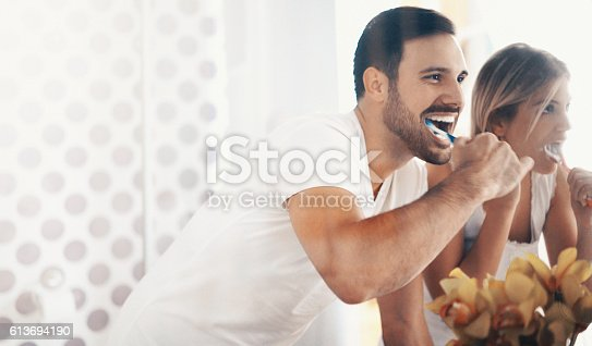 istock Couple brushing teeth in the morning. 613694190