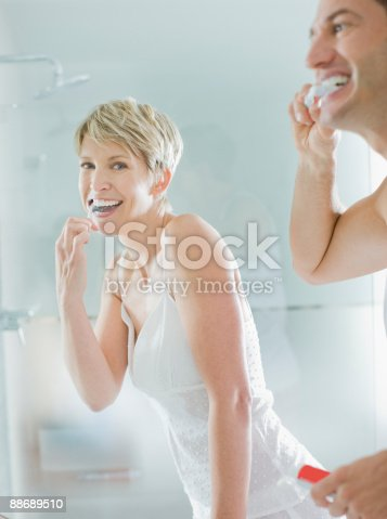 675462768istockphoto Couple brushing teeth in the morning 88689510