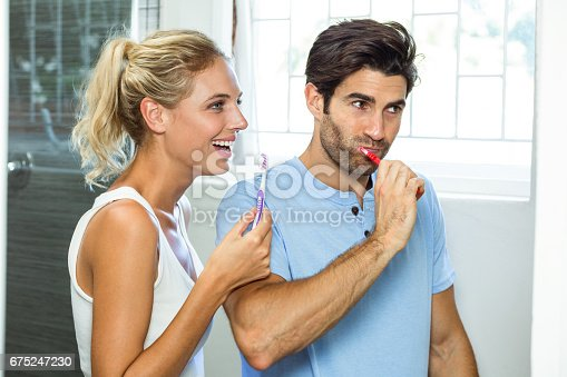 675462768istockphoto Couple brushing their teeth in bathroom 675247230