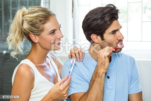 675462768istockphoto Couple brushing their teeth in bathroom 675247428