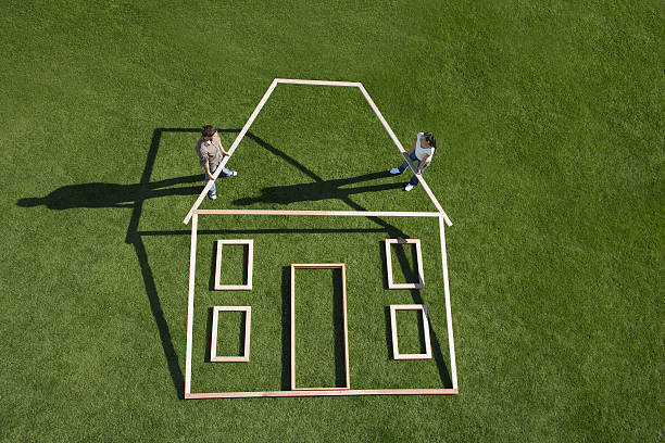 Couple building house outline stock photo