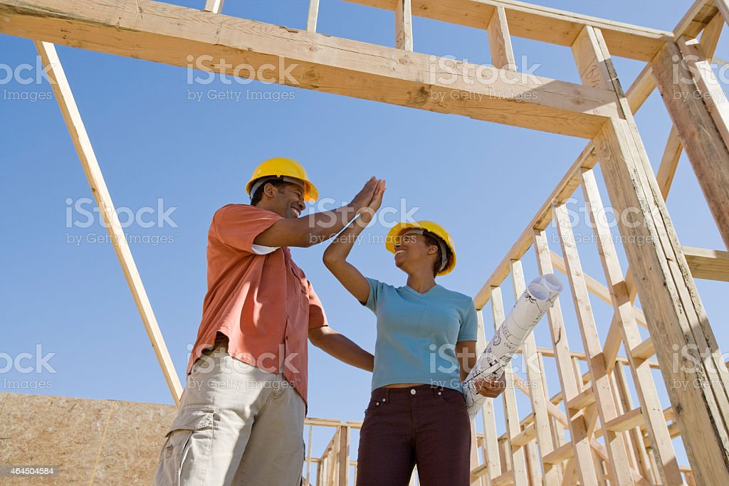 Couple building new home stock photo