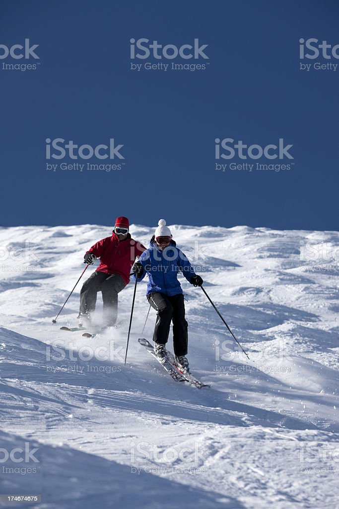Couple bump skiing royalty-free stock photo