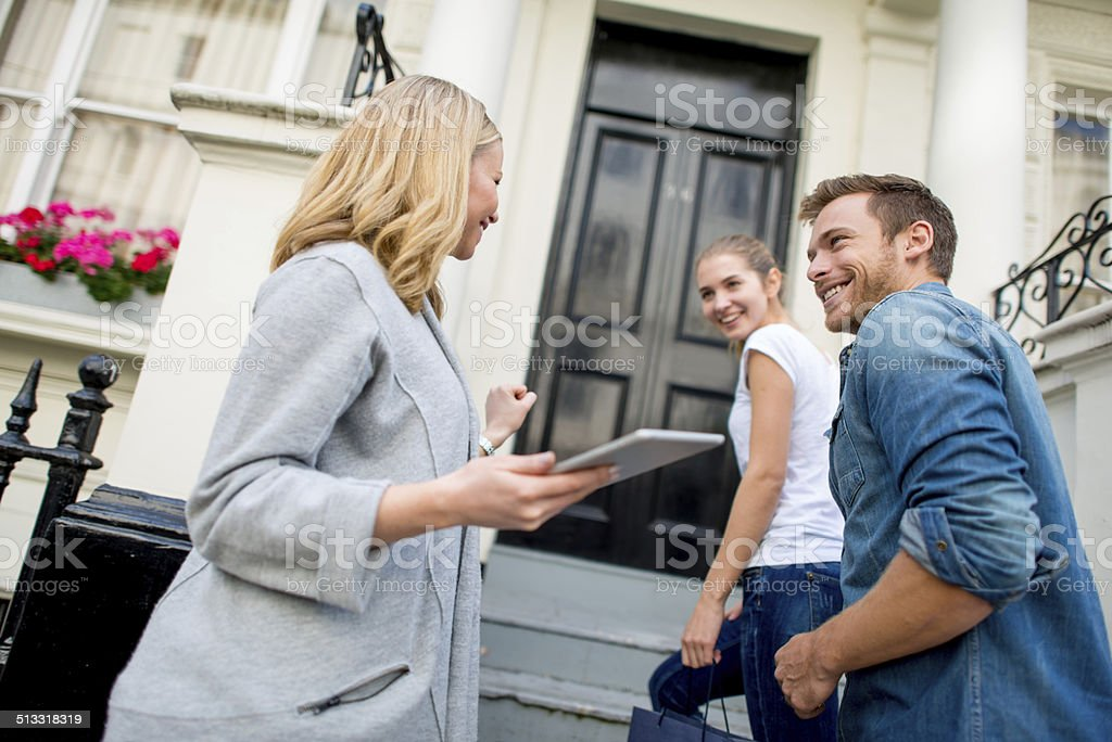 Couple buying a house stock photo