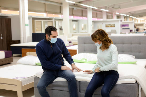 Couple buying a mattress stock photo