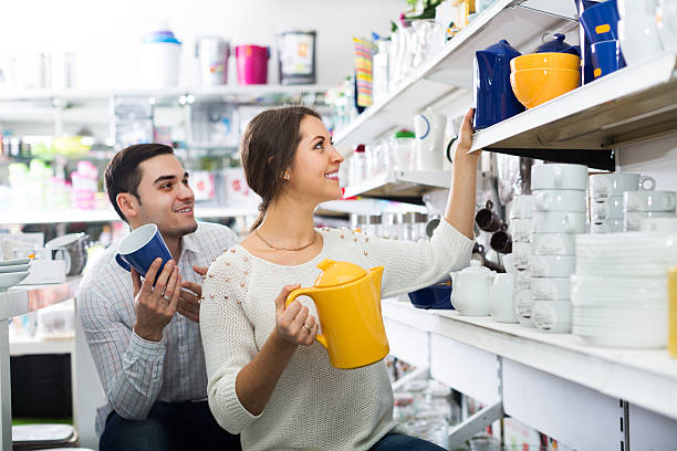 Couple buying ceramic stock photo