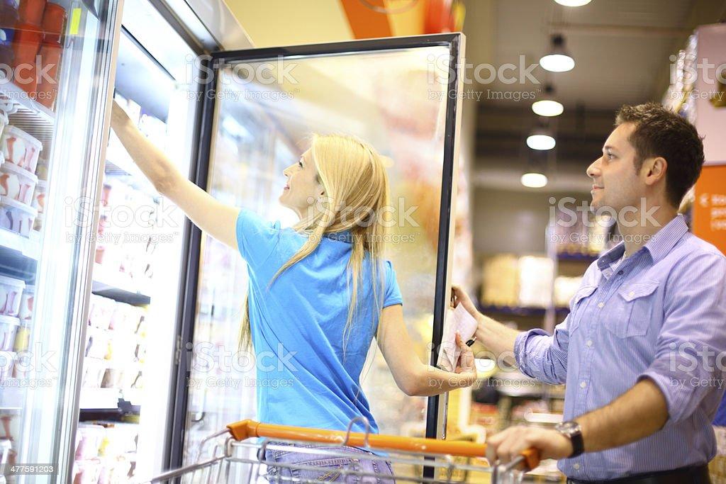 Couple buying frozen food. stock photo