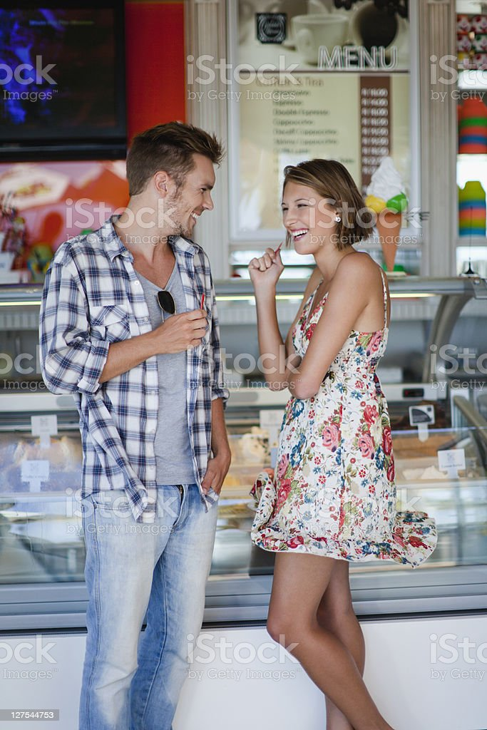 Couple buying ice cream together stock photo