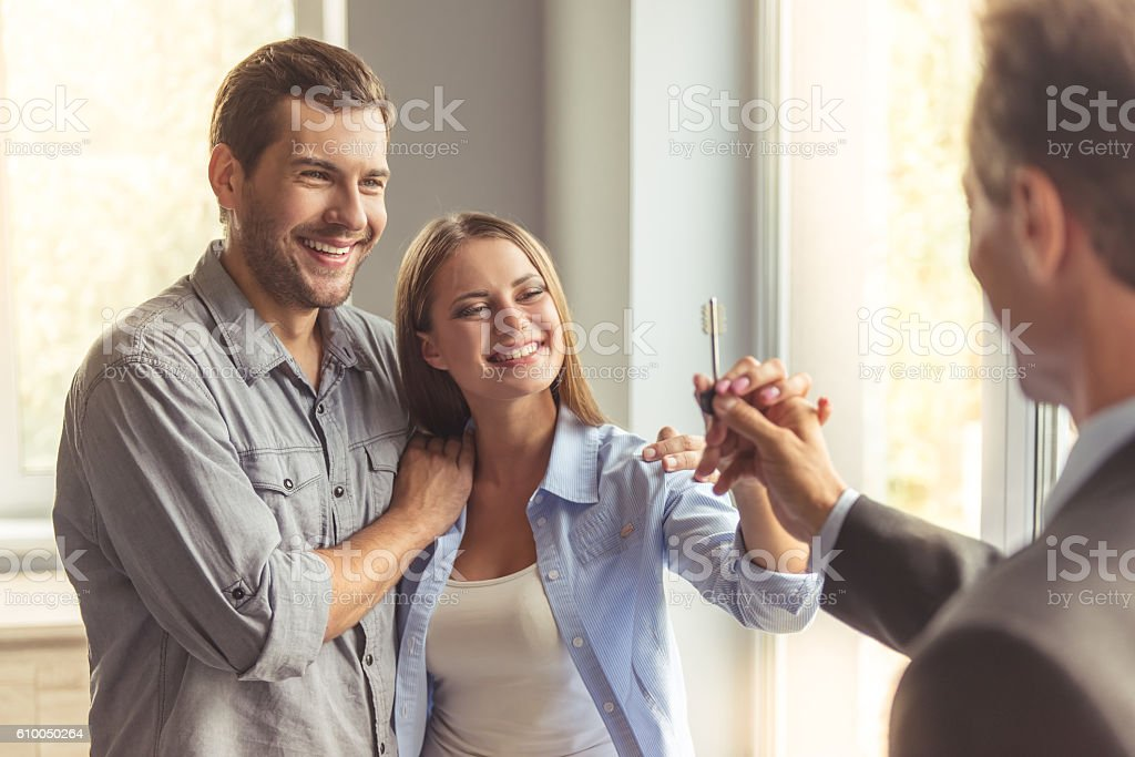 Couple Buying New Apartment stock photo | iStock