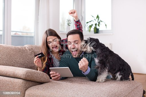 842971872 istock photo Couple buying online at home 1088090204