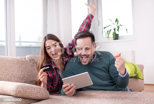 842971872 istock photo Couple buying online at home 1088090300