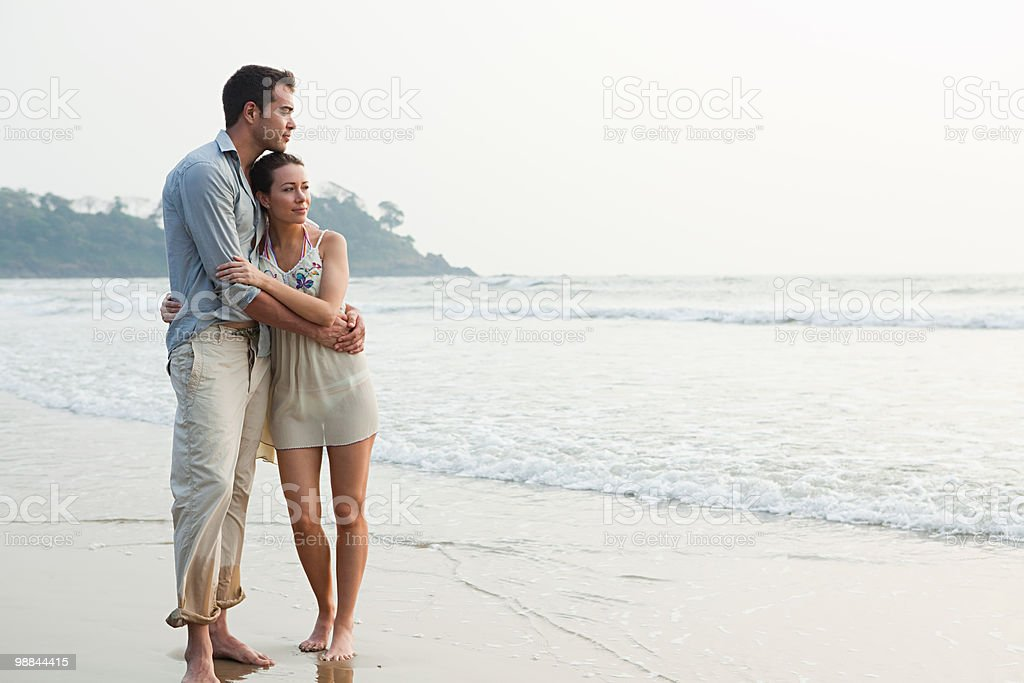 Couple by the ocean royalty free stockfoto