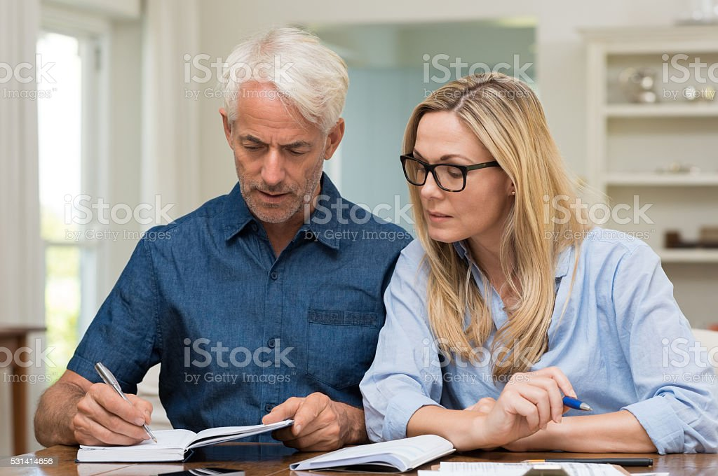 Couple calculating bills stock photo