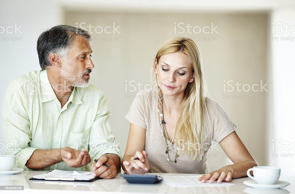 Couple calculating domestic bills royalty-free stock photo