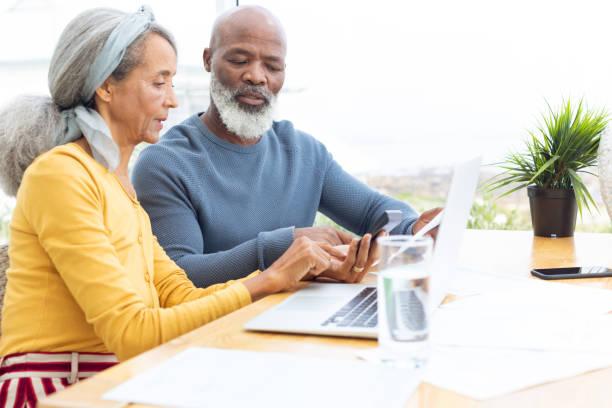 Couple calculating finances stock photo