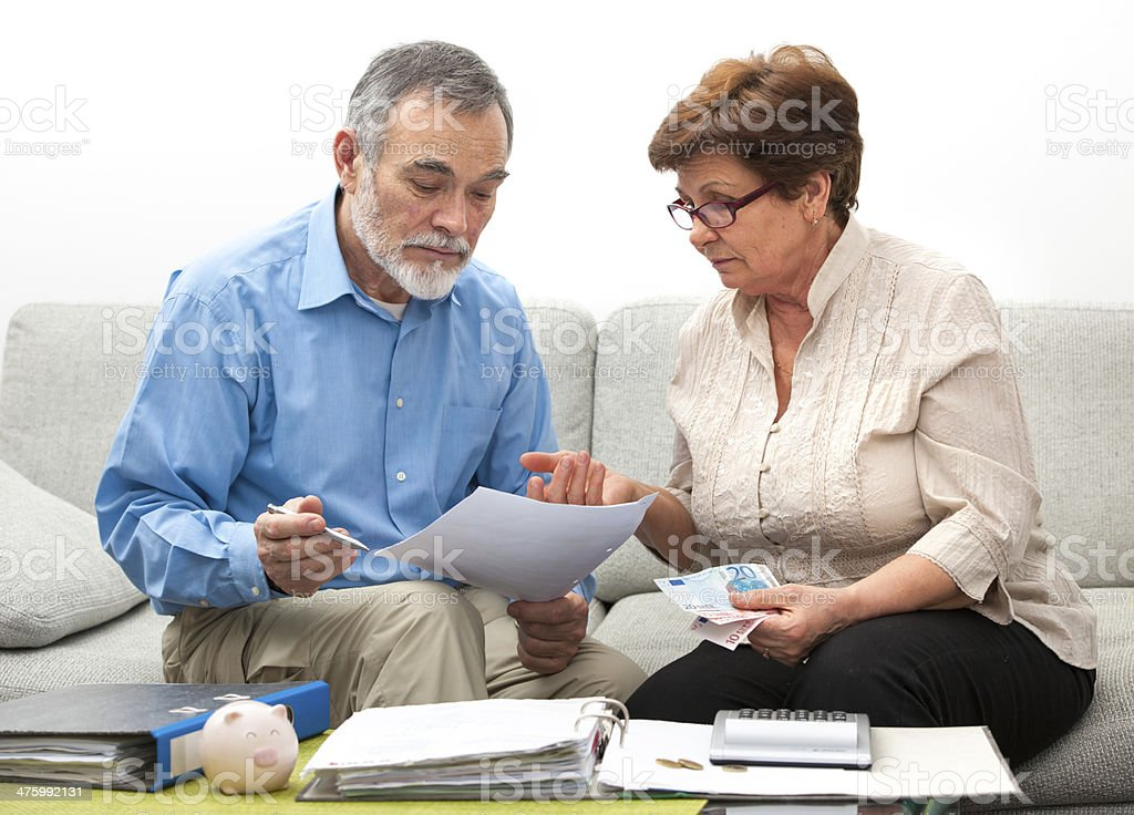 couple calculating home finances stock photo