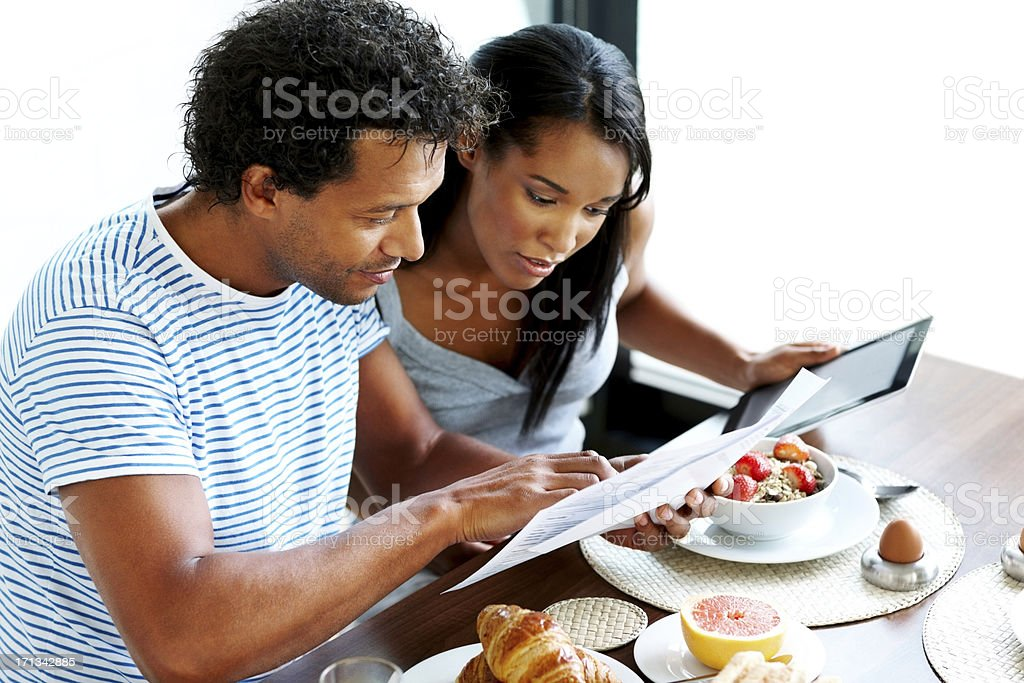 Couple calculating their home expenses stock photo