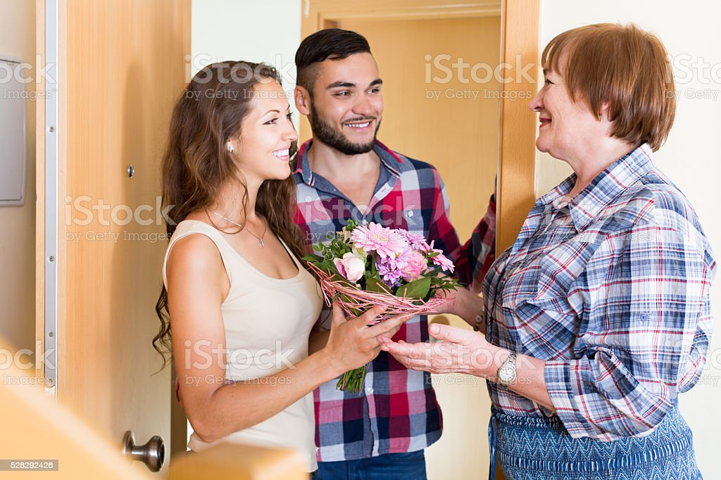 couple  came to visit mother at the parental home stock photo