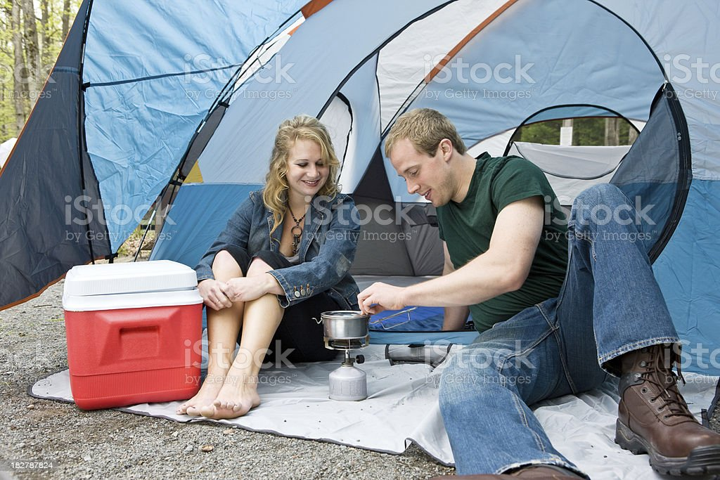 Couple Camping Cooking A Meal royalty-free stock photo