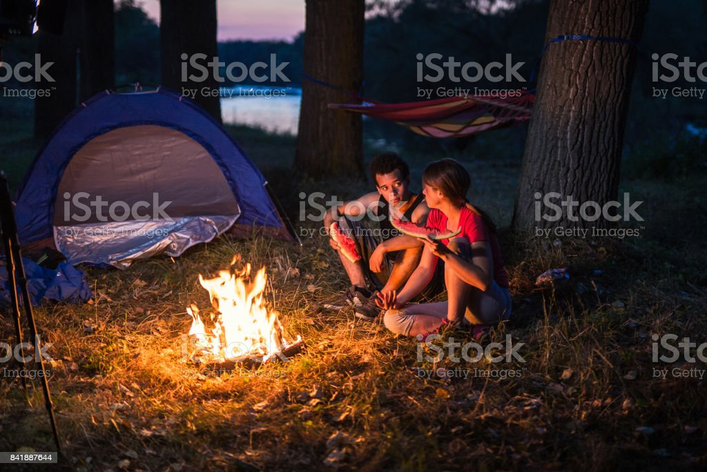 Couple camping near the river stock photo