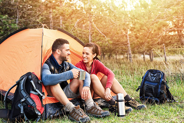 couple camping - camping stock photos and pictures