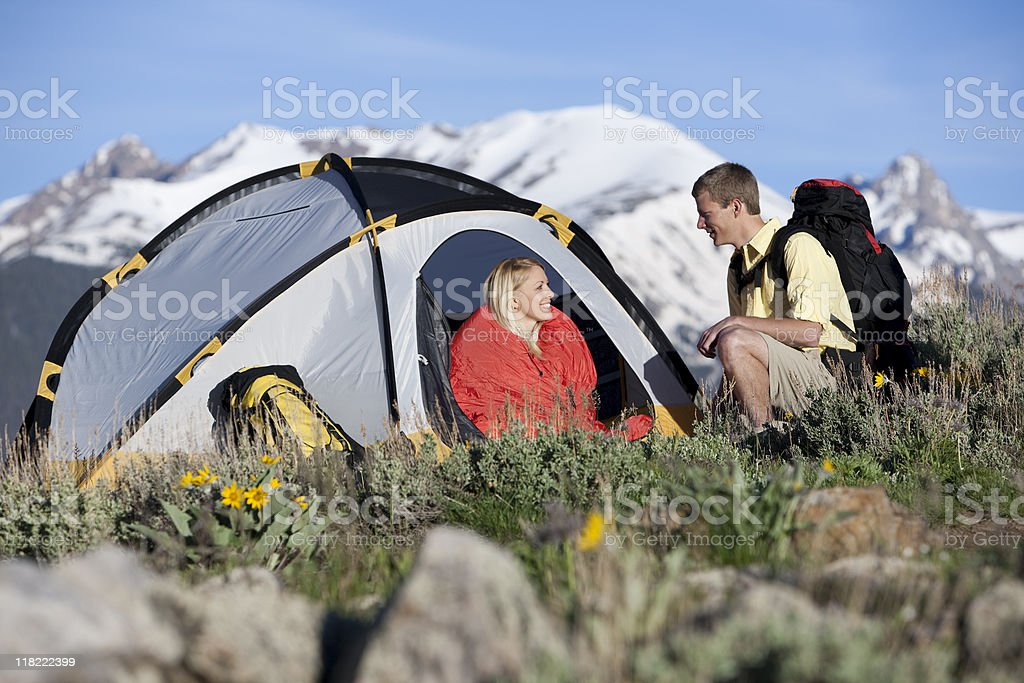 Couple Camping With Snow-covered Mountains In Background royalty-free stock photo