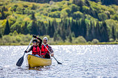istock Couple Canoeing at Parc National du Mont-Tremblant, Quebec, Canada 1174922095