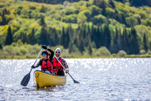 Couple Canoeing at Parc National du Mont-Tremblant, Quebec, Canada stock photo