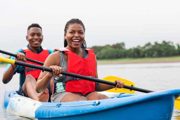 Couple canoeing in a lake Couple canoeing in a lake canoeing stock pictures, royalty-free photos & images