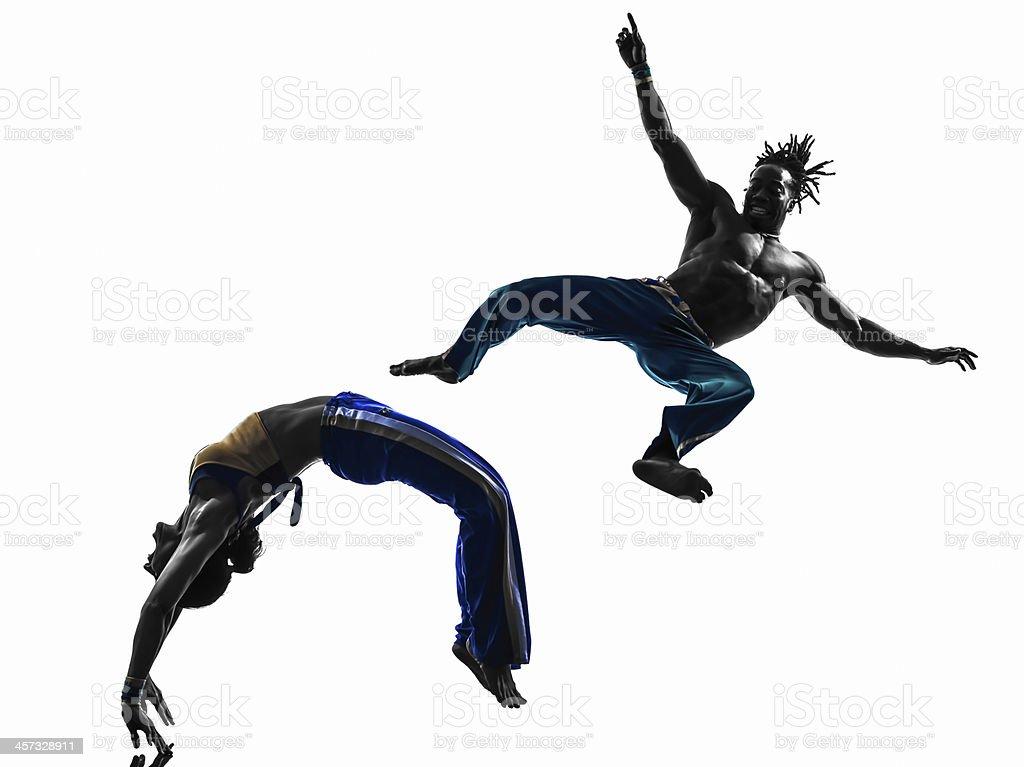 couple capoiera dancers dancing silhouette stock photo